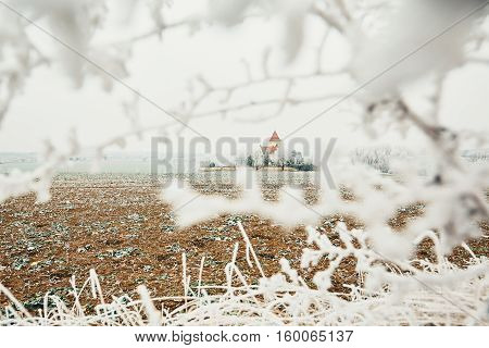 Small cemetery with a church amid frozen landscape Czech Republic