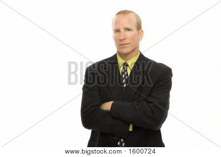Businessman Stands With Arms Crossed
