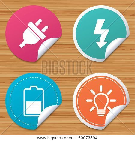 Round stickers or website banners. Electric plug icon. Light lamp and battery half symbols. Low electricity and idea signs. Circle badges with bended corner. Vector