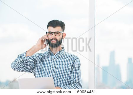 Handsome Man With Document On Phone