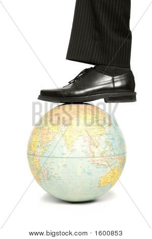 Businessman Steps On Globe