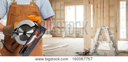 worker hands with electric saw