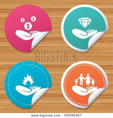 Round stickers or website banners. Helping hands icons. Financial money savings, family life insurance symbols. Diamond brilliant sign. Fire protection. Circle badges with bended corner. Vector
