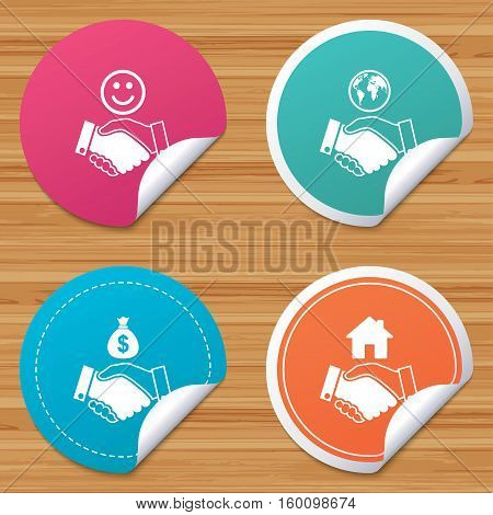 Round stickers or website banners. Handshake icons. World, Smile happy face and house building symbol. Dollar cash money bag. Amicable agreement. Circle badges with bended corner. Vector