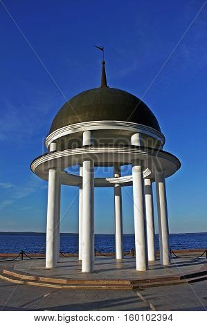 Petrozavodsk, Russia - 13 July 2014: Rotunda on the shore of lake Onega. Built in 1995. Rotunda is the decoration of the Onega embankment