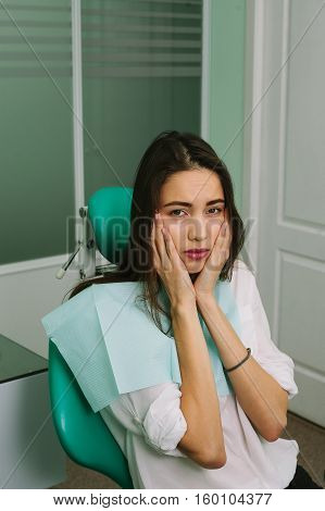 beautiful woman on reception at the dentist.