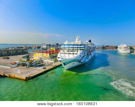 Venice, Italy - June 06, 2015: Cruise Ship Norwegian Jade by NCL docked at the port of Venice, Italy on a background of the roofs on June 06, 2015