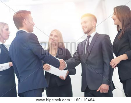 Handshake to seal a deal after a job recruitment meeting in a of