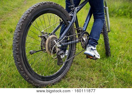 Young girl riding a mountain bike in the woods