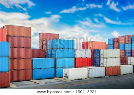 Industrial port with container yard in day blue sky with clouds