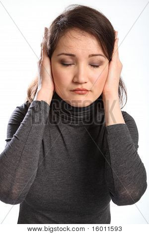 Woman with hands over ears