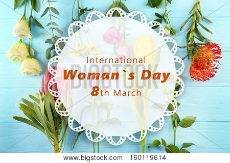 Text INTERNATIONAL WOMAN'S DAY, 8TH MARCH on beautiful flowers background
