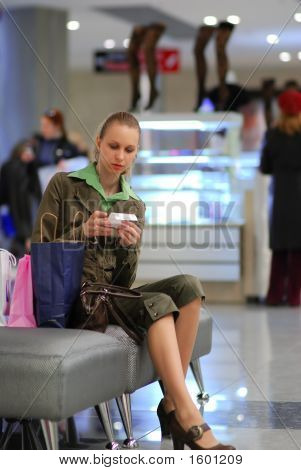 Girl Is Examining The Bill In Shopping Mall