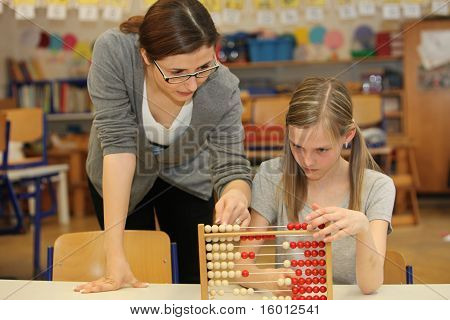 Teacher And Student In The Elementary School