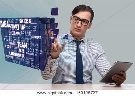 Businessman with tablet computer pressing buttons