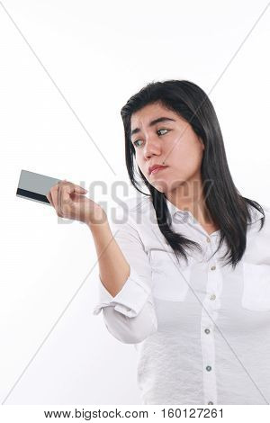 Photo image portrait of a beautiful cute young Asian woman looking sad to give her credit card economic depression bankruptcy concept close up portrait over white background