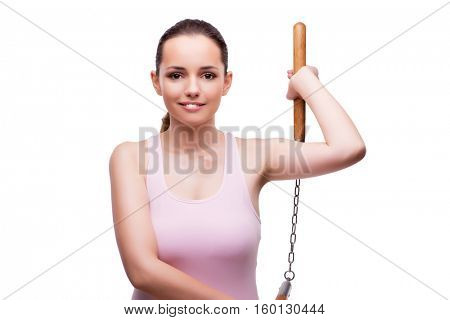 Young woman with nunchucks isolated on white