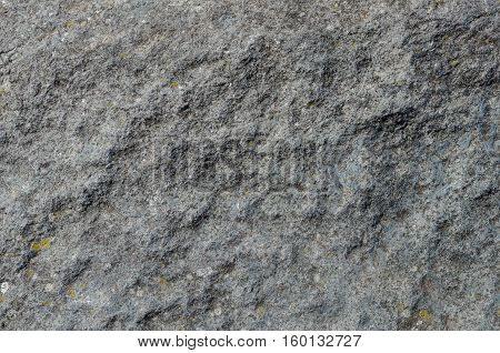 Texture of uneven grey rock surface background
