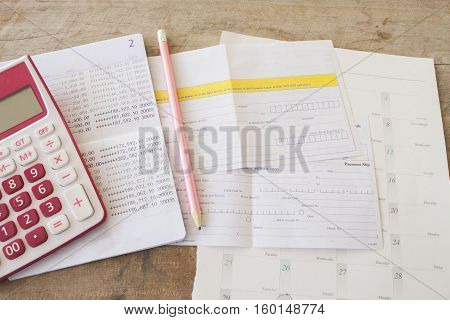 passbook bank and payment slip for financial expenses and income