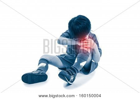Sports injury. Full body of asian soccer player painful. Child crying and touching his knee isolated on white background. Photo with color increase blue skin and red spot indicating location of pain.