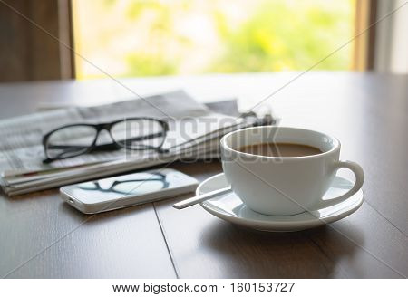Newspaper Reading Glasses Coffee Cup And Mobile Phone On Business Desk Business Newspaper Background