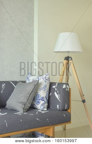 Wooden Base With Gray Upholstery Sofa And White Shade Wooden Floor Lamp