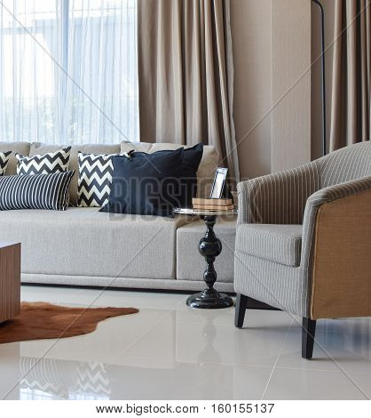 Stylish Living Room Design With Grey Striped Pillows On Comfortable Sofa