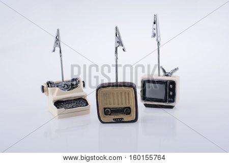 Retro Syled Tiny Television, Radio And Typewriter Model On White Background