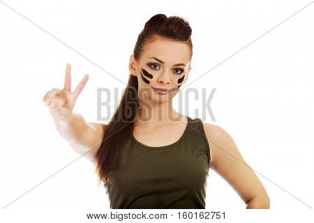 Military woman gesturing peace with fingers