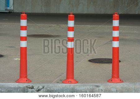 Rubber traffic pole with red and white color.