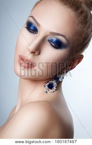 Portrait Of A Beautiful Young Woman. Blonde Girl With A Professional Make-up.