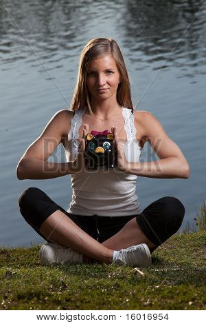 Young Woman Meditation Piggy Bank
