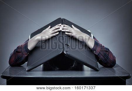 Tired Businesswoman Hiding Under Laptop