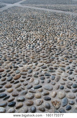 Background of stone pebbles. Abstract background. Natural stone. Stone road.