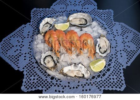 Seafood Cold Plate, oyster, tiger prawns, olives and lime