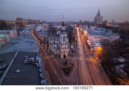Church of Nativity in Solyanka and two roads, panoramic view of evening Moscow, Russia, long exposure