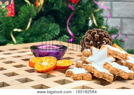 Christmas background with star shaped cookies and pine cone