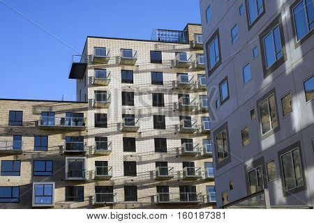 AARHUS DENMARK - NOVEMBER 24 2016: New modern apartment buildings with windows and balconies all over the new building on the port of Aarhus November 24 2016