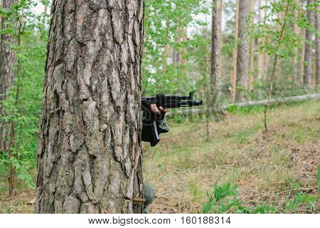 Armed man in a zone of armed conflict