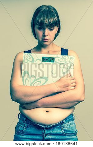 Frustrated Overweight Woman Holding Digital Scales With Help!