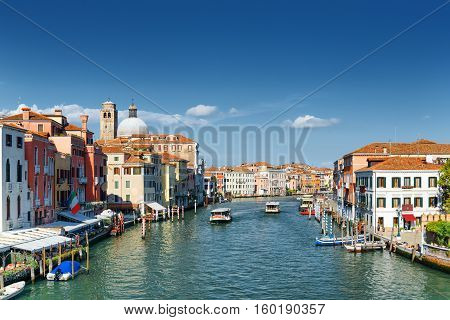 Water Buses Rides Along The Grand Canal In Venice, Italy