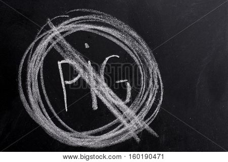 No pig sign drawn on the blackboard with chalk