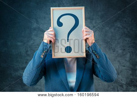Businesswoman with question mark looking for answers questioning and wondering about uncertain future in corporate business