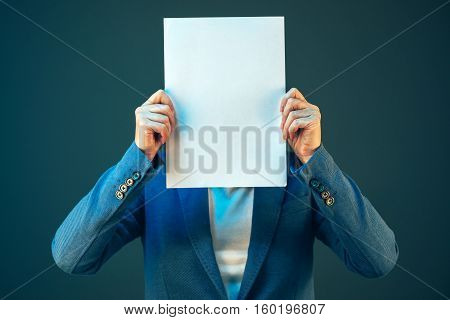Blank business document paper covering businesswoman's face copy space for text