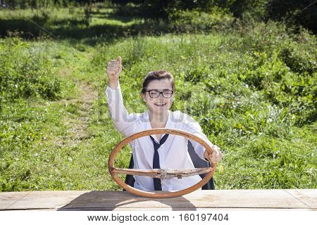 Happy Business Woman Sitting Behind The Wheel Of An Imaginary Car