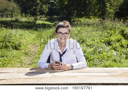 Smiling Business Woman Holding The Telephone In Her Hands