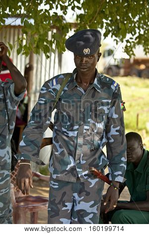BOR, SOUTH SUDAN-JUNE 24, 2012: Unidentified South Sudanese police officer at a checkpoint north of Bor, South Sudan