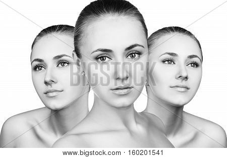 Three perfect faces of beautiful young woman isolated on white