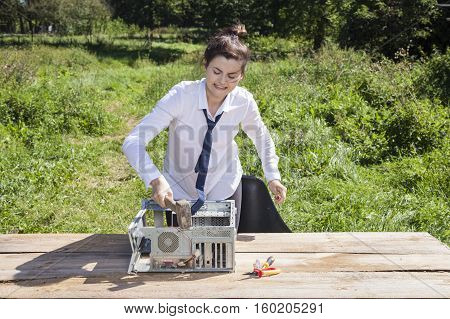 Business Woman Destroys The Computer With A Hammer