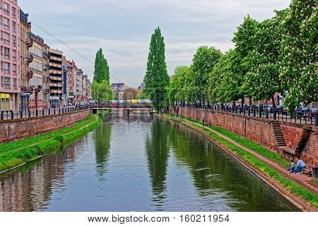 Strasbourg, France - May 5, 2012: Bridge over Canal du Faux-Rempart in the Grande Ile historic center of Strasbourg in France. People on the background